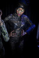 SOWETO, SOUTH AFRICA MAY 29: A model for the designer Inventive Fashion by Zamaswazi waits backstage before a fashion show at Soweto Fashion Week on May 29, 2014 at the Soweto Theatre in the Jabulani section of Soweto, South Africa. Local emerging designers showed their collections during the three-day event held at the theatre. Founded in 2012, Soweto fashion week gives a platform to local designers, models and artists. (Photo by: Per-Anders Pettersson)