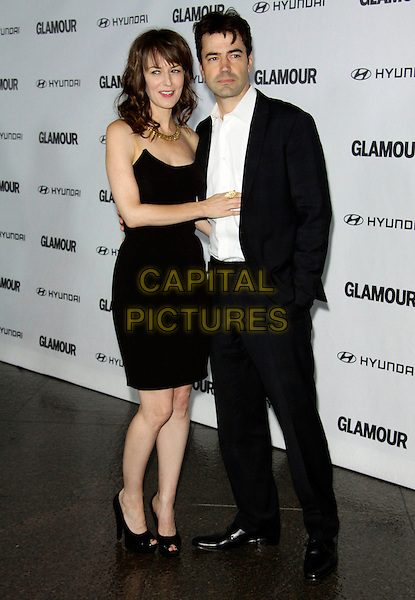 ROSEMARIE DeWITT & RON LIVINGSTON.The Glamour Reel Moments Presented by Hyundai held at The Directors Guild of America in West Hollywood, California, USA..October 25th 2010.full length black dress strapless peep toe shoes platform couple suit white shirt .CAP/ADM/TC.©T. Conrad/AdMedia/Capital Pictures.