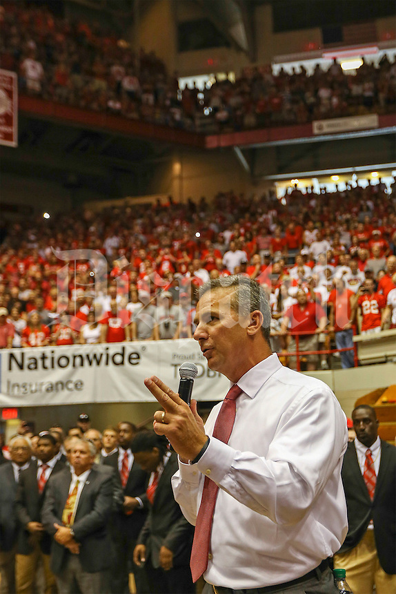 Ohio State Buckeyes head coach Urban Meyer lets the masses of loyal fans in St. John Arena know they can expect a Buckeye victory before the NCAA football game at Ohio Stadium in Columbus on Sept. 7, 2013. (Alex Holt / The Columbus Dispatch)