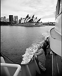 Australia just before the 2000 summer olympics. Protests, olympic trials, the Opera House, sydney harbour and a look inside the lifestyle of the Ozzies.