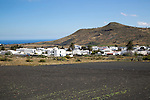 View over cactus black soil field and whitewashed houses, village of Maguez, Lanzarote, Canary Islands, Spain