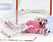 Kendall Coyne's shot gets past Kerrin Sperry (BU - 1) to open scoring in the game. - The Boston University Terriers defeated the visiting Northeastern University Huskies 3-2 on Saturday, January 28, 2012, at Agganis Arena in Boston, Massachusetts.