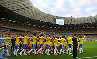 David Luiz leads the Brazil team out before kick off as they all put their hands on each others shoulders
