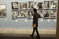 Visitor views the exhibition of american fashion photographer Helmut Newton in Budapest, Hungary on April 02, 2013. ATTILA VOLGYI