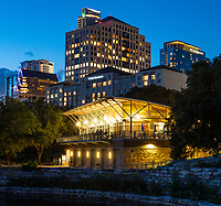 Texas Rowing club on Lady Bird Johnson lake in downtown Austin at night cityscape. In this image we capture the rowing clubs along with the Four Season Hotel along with the new Marriott and the Austonian Austin tallest skyscrape along with other parts of the cityscape.