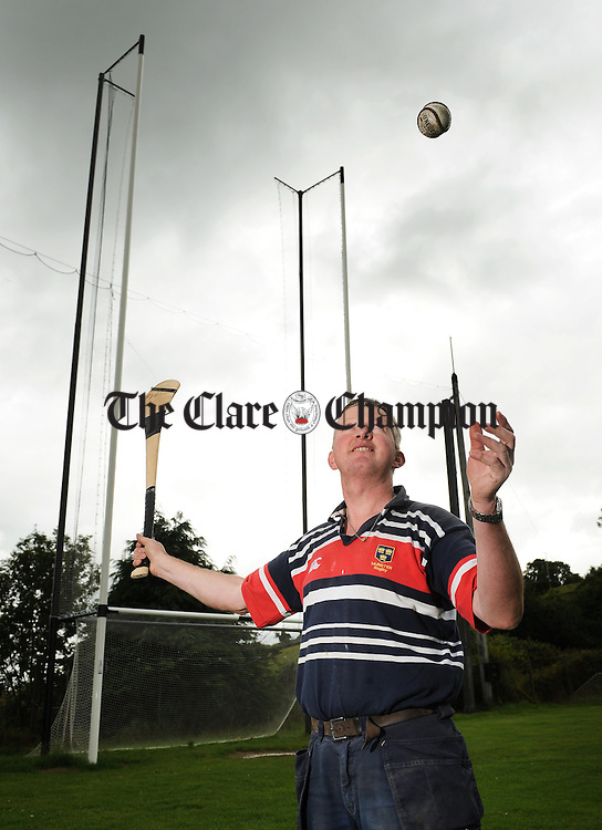 Michael Mc Mahon, originally from Feakle but now living in Tulla, with the newly designed Ball Entrapment Device installed as a prototype with the goalposts at Scariff GAA field. Photograph by John Kelly.