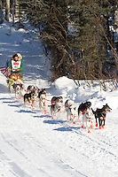 Musher G.B. Jones on Long Lake at the Re-Start of the 2011 Iditarod Sled Dog Race in Willow, Alaska.