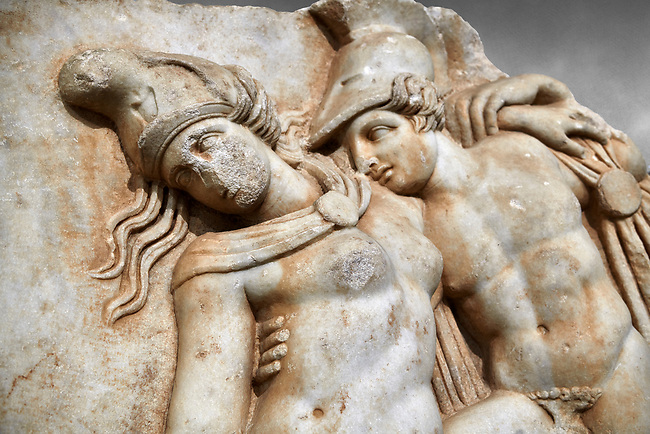 Detail of a Roman Sebasteion relief sculpture of Achilles and a dying Amazon, Aphrodisias Museum, Aphrodisias, Turkey.   <br /> <br /> Achilles supports the dying Amazon queen Penthesilea whom he has mortally wounded. Her double headed axe slips from her hands. The queen had come to fight against the Greeks in the Trojan war and Achilles fell in love with her.