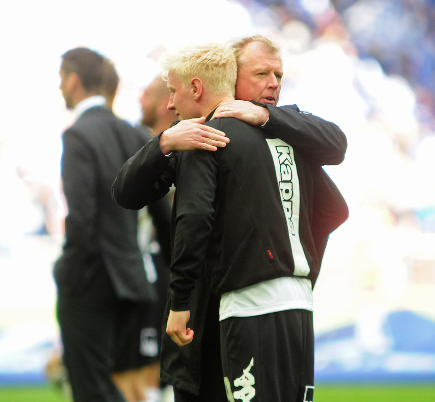 Derby County's Manager Steve McClaren hugs a dejected Will Hughes at the end of the game<br /> <br /> Photographer Chris Vaughan/CameraSport<br /> <br /> Football - The Football League Sky Bet Championship Play-Off Final - Derby County v Queens Park Rangers - Saturday 24th May 2014 - Wembley Stadium - London<br /> <br /> &copy; CameraSport - 43 Linden Ave. Countesthorpe. Leicester. England. LE8 5PG - Tel: +44 (0) 116 277 4147 - admin@camerasport.com - www.camerasport.com