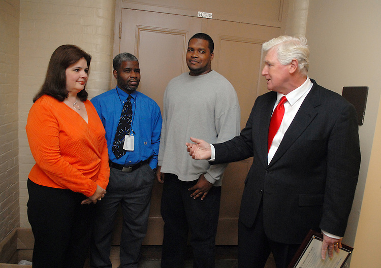 Rep. Jim Moran, D-Va., congratulates employees of the U.S. Capitol flag office who apprehended a man that broke into the building last week.  They decline to give their names. (LtoR) Karen Livingston, Anthony Dennis and Isaac Livingston.