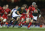 Springbok flanker Willem Alberts chases Wales center Jonathan Davies.<br /> <br /> 2013 Dove Men Series<br /> Wales v South Africa<br /> Millennium Stadium<br /> 09.11.13<br /> &copy;Steve Pope-Sportingwales