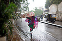 Mumbai, India<br /> Bandra West area mum carries child with balloons<br /> <br /> Picture by Gavin Rodgers/ Pixel8000<br />  07917221968