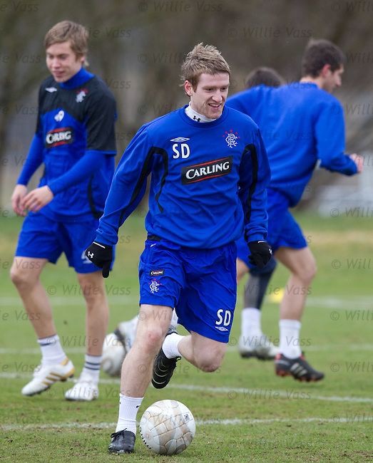 Steven Davis zips off with the ball at training