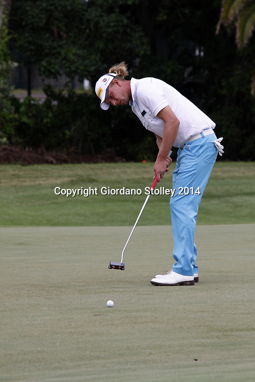 DURBAN - 10 January 2014 - Germany's Marcel Siem plays a shot on the green of the 16th hole at the Durban Country Club in the Volvo Golf Champions. Picture: Allied Picture Press/APP