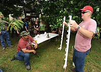 NWA Democrat-Gazette/ANDY SHUPE<br /> Ken Coffey (right), co-owner of a sheep and goat farm west of Prairie Grove, speaks Wednesday, June 14, 2017, about fencing to a group of veterans participating in the National Center for Appropriate Technology's Armed to Farm program during a tour of Coffey's farm.