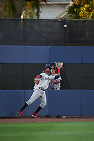 Mahoning Valley Scrappers left fielder Oscar Gonzalez (39) catches a fly ball as Jonathan Teaney (30) looks on in the bullpen during a game against the Williamsport Crosscutters on July 8, 2017 at BB&T Ballpark at Historic Bowman Field in Williamsport, Pennsylvania.  Williamsport defeated Mahoning Valley 6-1.  (Mike Janes/Four Seam Images)