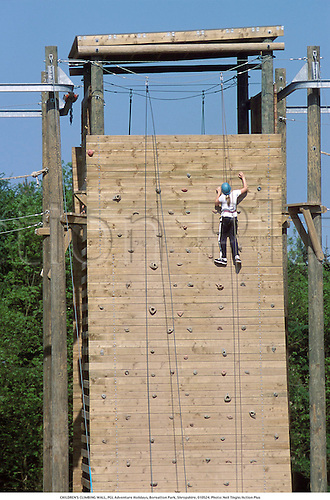 A young girl on a climbing wall, PGL Adventure Holidays, Boreatton Park, Shropshire, 010524. Photo: Neil Tingle/Action Plus...2001.child climb climber.children.kids.Youngster.Youngsters.childrens sport.children's sport.female