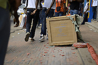 Inhabitants walks through on hundred meters long of firecrackers already lay on a sidewalk.....End of year 2010 celebrations on the streets of Paramaribo. Suriname is one of biggest consumer in South America that using firecrackers, fireworks ( also locally known as pagara ) for celebrations, especially for end of every years and also beginning of every new Chinese Years.