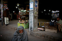 Homeless men slowly wake up near a bus station in the city of Rawalpindi, Pakistan on friday November 28 2008.///..While Bangladesh, India, Nepal and Maldives all suffer from drug consumption, Pakistan is the worst victim of the drug trade in South Asia. Today, the country has the largest heroin consumer market in the south-west Asia region..The drug addicts resort to crime for generating income for the purchase of narcotics. The situation is becoming serious due to the number of heroin addicts in the country. An alarming rate of increase of 100,000 addicts per year is highly dangerous to society. The drug addicts are affecting nearly 20 million dependents and family members with psychological, social, and economic repercussions.