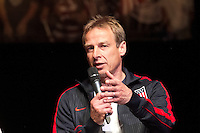 U.S. head coach Jurgen Klinsmann answers a question on the stage at the Paramount Theater in Denver, CO during the USA Men's National Team prep rally on March 21, 2013.