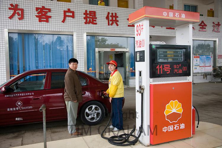 Filling up car at a petrol station, Yang shan near Guilin, China