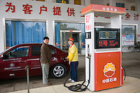 Filling up car at a petrol station, Yang shan near Guilin, China