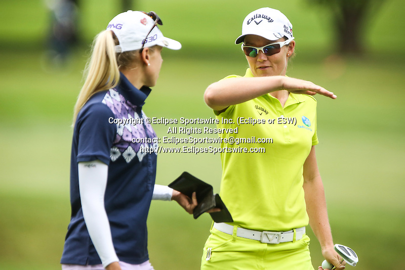 Pernilla Lindberg (left) and Stacey Keating (right) chat before going to the 8th tee  at the LPGA Championship 2014 Sponsored By Wegmans at Monroe Golf Club in Pittsford, New York on August 16, 2014
