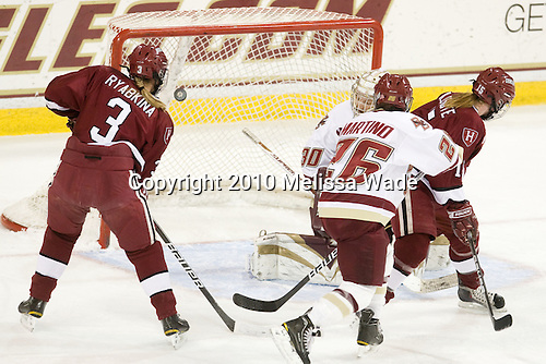 Liza Ryabkina (Harvard - 3) watches Kate Buesser's shot get past Molly Schaus (BC - 30) to tie the game. - The Boston College Eagles defeated the visiting Harvard University Crimson 6-2 on Sunday, December 5, 2010, at Conte Forum in Chestnut Hill, Massachusetts.