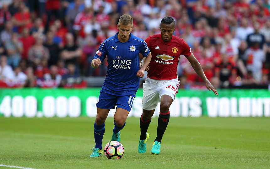 Leicester City's Andy King and Manchester United's Luis Antonio Valencia<br /> <br /> Photographer Stephen White/CameraSport<br /> <br /> Football - The FA Community Shield - Leicester City v Manchester United - Sunday 7 August 2016 - Wembley Stadium - London<br /> <br /> World Copyright &copy; 2016 CameraSport. All rights reserved. 43 Linden Ave. Countesthorpe. Leicester. England. LE8 5PG - Tel: +44 (0) 116 277 4147 - admin@camerasport.com - www.camerasport.com
