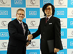 November 21, 2016, Tokyo, Japan - Japan's Tsukuba University professor and high-tech venture Cyberdyne president Yoshiyuki Sankai (R) shakes hands with insurance company AIG Japan Holdings president Robert Noddin (L) as they exchange documents on their agreement for business collaboration at a press conference at AIG Japan headquarters in Tokyo on Monday, November 21, 2016. AIG Japan will develop insurance products and related services using Cyberdyne's robot suit Hybrid Assistive Limb (HAL) and other technologies such as vital sensors.   (Photo by Yoshio Tsunoda/AFLO) LWX -ytd-
