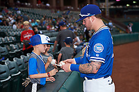 Oklahoma City Dodgers right fielder Alex Verdugo (27) signs autographs for young fans before a game against the Colorado Springs Sky Sox on June 2, 2017 at Chickasaw Bricktown Ballpark in Oklahoma City, Oklahoma.  Colorado Springs defeated Oklahoma City 1-0 in ten innings.  (Mike Janes/Four Seam Images)