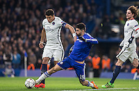 Thiago Silva of Paris Saint-Germain manages to beat Diego Costa of Chelsea to the ball in the penalty area during the UEFA Champions League Round of 16 2nd leg match between Chelsea and PSG at Stamford Bridge, London, England on 9 March 2016. Photo by Andy Rowland.