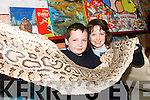 SNAKES ALIVE: Joshua and Mary Kate McGuire  from Bouleensheer National School in Ballyheigue with the skin of the three metre phyton that was shot over 55 years ago..