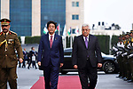Palestinian President Mahmoud Abbas and Japanese Prime Minister Shinzo Abe review the honor guard during a welcome ceremony in the West Bank city of Ramallah on May 1, 2018. Abe is on a Middle East tour which will took him to the UAE, Jordan, Israel and the Palestinian territories. Photo by Thaer Ganaim