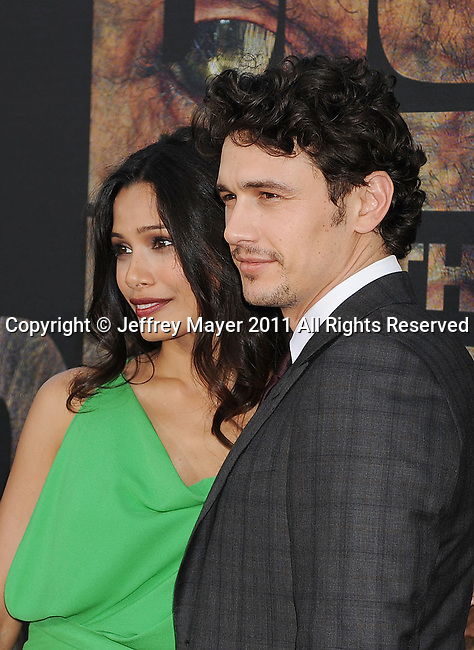 """HOLLYWOOD, CA - JULY 28: Freida Pinto and James Franco arrive at the """"Rise Of The Planet Of The Apes"""" Los Angeles Premiere at Grauman's Chinese on July 28, 2011 in Hollywood, California."""