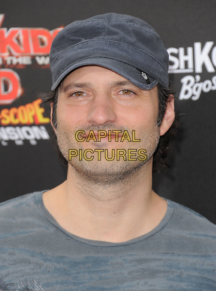 "Robert Rodriguez.The World Premiere of ""Spy Kids: All the Time in the World in 4D"" held at The Regal Cinames, L.A. Live in Los Angeles, California, USA..July 31st, 2011               .headshot portrait grey gray hat stubble facial hair .CAP/RKE/DVS.©DVS/RockinExposures/Capital Pictures."