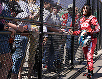 SAMAX Motorsport driver Milka Duno signs autographs during practice laps for the Kansas Lottery Indy 300 at Kansas Speedway in Kansas City, Kansas on April 28, 2007.