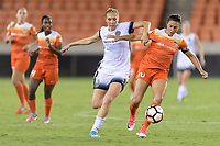 Houston, TX - Saturday July 08, 2017: Allie Long and Carli Lloyd battle for control of the ball during a regular season National Women's Soccer League (NWSL) match between the Houston Dash and the Portland Thorns FC at BBVA Compass Stadium.