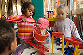 Children play at a sandpit in Warwick Day Nursery, Warwick Estate, Paddington, London