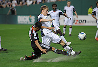 DC United midfielder Andy Najar (14) makes a pass while cover by New England Revolution defender Seth Sinovic (27). New England Revolution defeated DC United 2-0,  at  RFK Stadium, Saturday April 3, 2010.