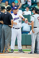 Winston-Salem Dash and Carolina League All-Star manager Tommy Thompson #39 meets with the umpires and California League All-Star manager David Newhan #9 of the Lake Elsinore Storm during the 2012 California-Carolina League All-Star Game at BB&T Ballpark on June 19, 2012 in Winston-Salem, North Carolina.  The Carolina League defeated the California League 9-1.  (Brian Westerholt/Four Seam Images)