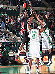 Arkansas State Red Wolves forward Martavius Adams (13) goes up for a jump shot over North Texas Mean Green forward George Odufuwa (4) during the NCAA  basketball game between the Arkansas State Red Wolves and the University of North Texas Mean Green at the North Texas Coliseum,the Super Pit, in Denton, Texas. UNT defeated Arkansas State 83 to 64..