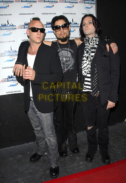 STEPHEN PERKINS, DAVE NAVARRO & STEVE ISAACS.The Rockstar Supernova kick off party held at The Roxy in West Hollywood, California, USA. .July 13th, 2006.Ref: DVS.full length black jacket arms over shoulder sunglasses shades.www.capitalpictures.com.sales@capitalpictures.com.Supplied By Capital PIctures