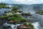 A tranquil scene on the Iguazu River in Iguazu Falls National Park in Argentina.  A UNESCO World Heritage Site.  Just a few feet away, the river plunges over the powerful San Marin Waterfall, dropping over 200 feet.