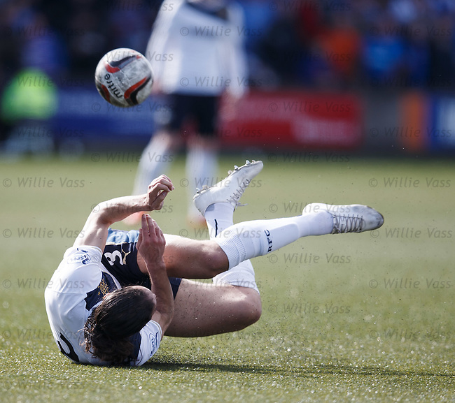 Bilel Mohsni trips and stumbles over the ball