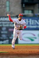 Second baseman Yoan Moncada of the Greenville Drive plays a ground ball in the second game of his pro career against the Lexington Legends on Tuesday, May 19, 2015, at Fluor Field at the West End in Greenville, South Carolina. The Cuban-born 19-year-old Red Sox signee has been ranked the No. 1 international prospect in baseball by Baseball America. (Tom Priddy/Four Seam Images)