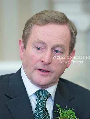 Prime Minister Enda Kenny of Ireland makes remarks as he meets United States President Barack Obama in the Oval Office of the White House in Washington, D.C. on Friday, March 14, 2014.<br /> Credit: Ron Sachs / Pool via CNP