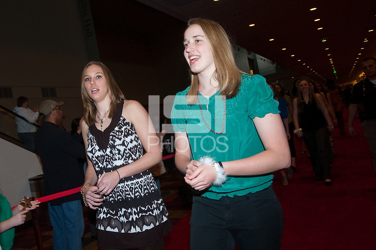 INDIANAPOLIS, IN - APRIL 1, 2011: Kayla Pedersen and Mikaela Ruef enjoy the festivities at the Cirque du Salute at the Indianapolis Convention Center at Tourney Town during the NCAA Final Four in Indianapolis, IN on April 1, 2011.