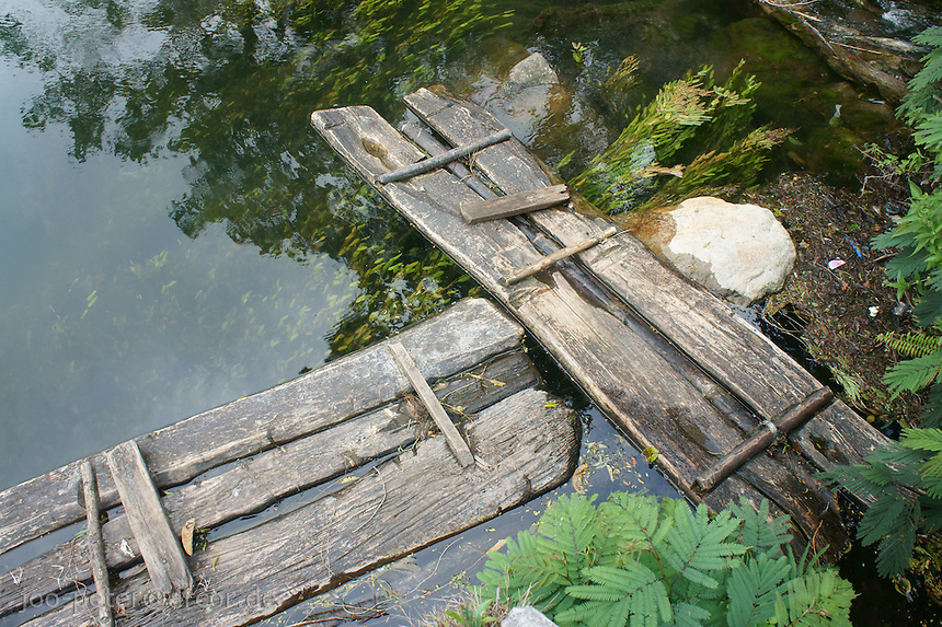 wooden platforms  at the border of lake Ranamese close to Ruteng, island  Flores in archipelago of Indonesia. Accodring to local legend, this lake is magic and spelled, bathing in the lake is supposed to be dangerous.