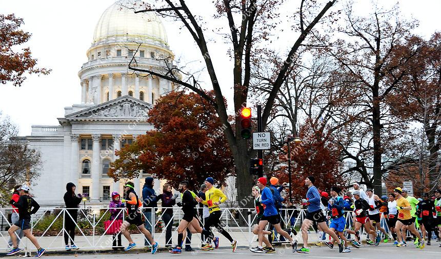 Runners start the full marathon during the 2014 Madison Marathon on Sunday, November 9, 2014, in Madison, Wisconsin